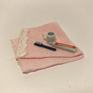 Tandbørstesæt m/håndklæde i 4 dele