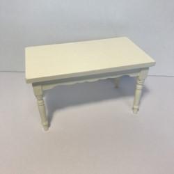 Hvid bord med udskæringer